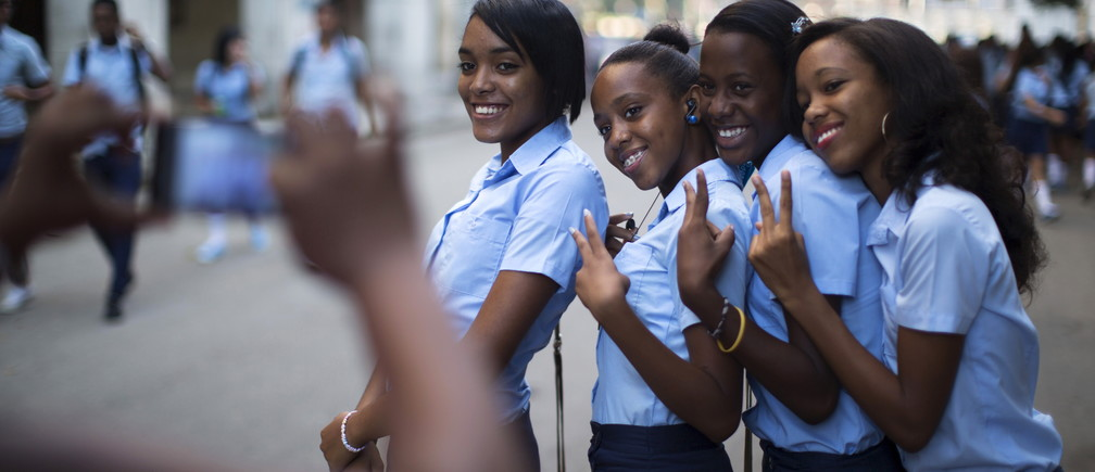 Pre-university students pose for a photo during the first day of class for the 2015-2016 course in downtown Havana, September 1, 2015.