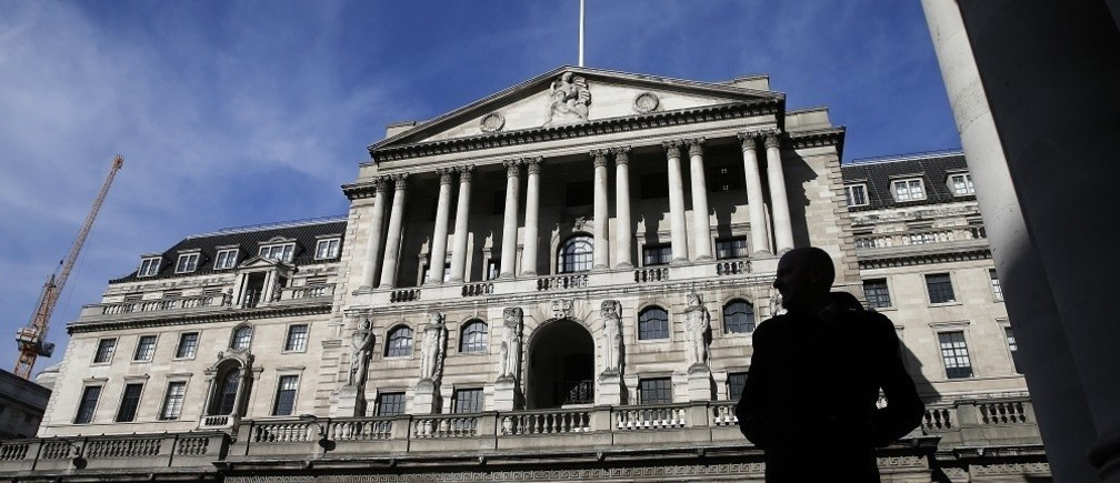 A pedestrians walks under an arch opposite the Bank of England in London March 5, 2015.