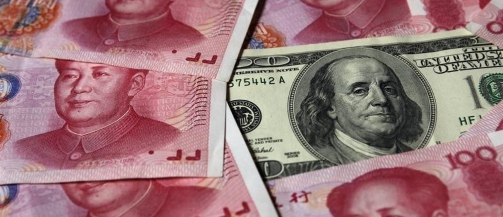 A U.S. $100 banknote is placed next to 100 yuan banknotes in this picture illustration taken in Beijing October 16, 2010. The United States fired the first shot in the currency war and the rest of the world must be on guard for its deliberate strategy to devalue the dollar, a Chinese economist said in an official newspaper on Thursday. REUTERS/Petar Kujundzic (CHINA - Tags: BUSINESS IMAGES OF THE DAY) - GM1E6AG0V7A01
