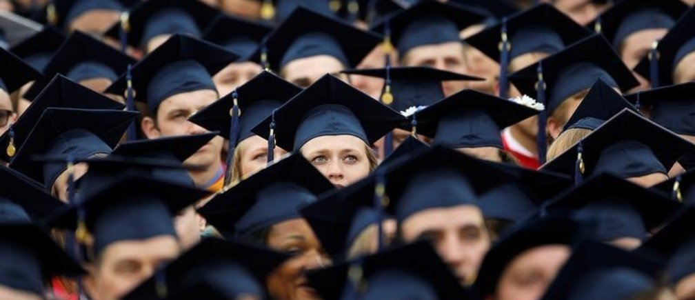 Graduates wait for the start of commencement exercises at Liberty University in Lynchburg, Virginia, U.S., May 11, 2019.  REUTERS/Jonathan Drake - RC11E99D9560