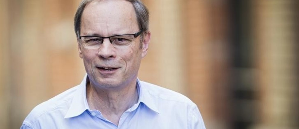 French economist Jean Tirole poses before a news conference at the Toulouse School of Economics in Toulouse October 13, 2014. French economist Jean Tirole won the 2014 economics Nobel Prize for his analysis of market power and regulation, the Royal Swedish Academy of Sciences said on Monday.   REUTERS/Fred Lancelot  (FRANCE - Tags: BUSINESS EDUCATION SCIENCE TECHNOLOGY HEADSHOT)