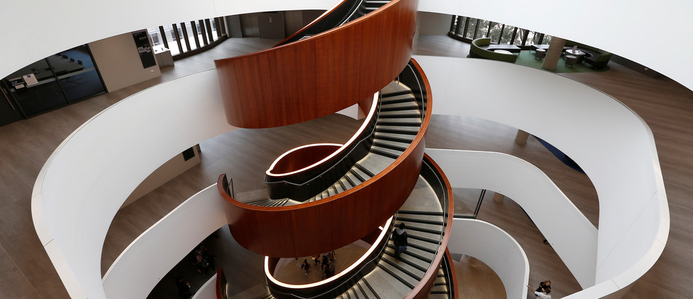 A circular staircase takes students up and down the floors of the Abercrombie business school building at the University of Sydney.