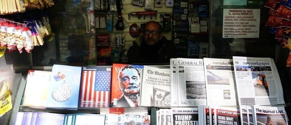 """A news stand outfitted with """"Fake News"""" headlines for a stunt pulled off by the Columbia Journalism Review is pictured in the Manhattan borough of New York, New York, U.S., October 30, 2018. REUTERS/Carlo Allegri - RC1219EFF020"""