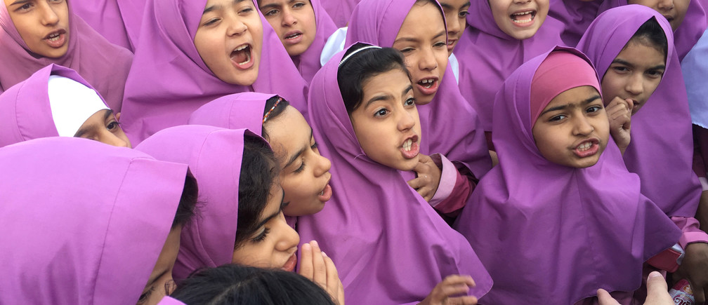 Iranian and Afghan girls gather at the Emam Hasan Mojtaba school in Kerman, Iran, October 23, 2016