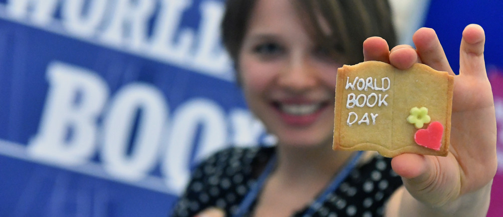 Woman holding World Book Day cookies that were given to passers-by at the World Book and Copyright Day 2019 in Vienna, Austria. 29 April 2019.