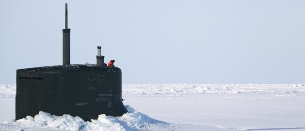 A US Navy sailor looks off the bridge of the Seawolf class submarine USS Connecticut after surfacing through Arctic sea ice during an exercise near the 2011 Applied Physics Laboratory Ice Station north of Prudhoe Bay, Alaska March 18, 2011.  REUTERS/Lucas Jackson (UNITED STATES - Tags: MILITARY SCI TECH BUSINESS ENVIRONMENT TRANSPORT) - GM1E73O0FW901
