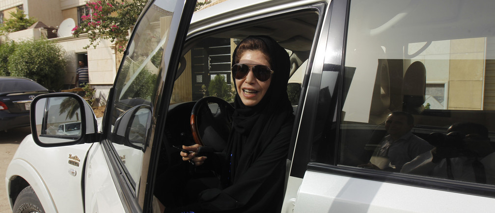 Female driver Azza Al Shmasani alights from her car after driving in defiance of the ban in Riyadh June 22, 2011. Saudi Arabia has no formal ban on women driving. But as citizens must use only Saudi-issued licences in the country, and as these are issued only to men, women drivers are anathema. An outcry at the segregation, which contributes to the general cloistering of Saudi women, has been fuelled by social media interest in two would-be female motorists arrested in May.
