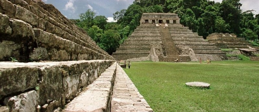 TO GO WITH BC-MEXICO-ARCHEOLOGY - A tourist climbs up the side of one of Palenque's Maya pyramids August 14. Palenque, considered the jewel in the crown of the Maya world, stretches over an area of 20 square kilometres, of which only 20% has been uncovered. Over 100 buildings have been documented, but unexplored, in the thick jungle in which the Maya city is set. During excavation of one of these unexplored sites, archeologists believe they have uncovered the first image of Palenque's only undocumented leader from the period of AD 732 to 764 from which they had no previous references. They believe the figure to be the missing leader of this undocumented period due to regal glyphs and glyphs dating the figure to the period in question.AW/AA - RP1DRIFVRCAB