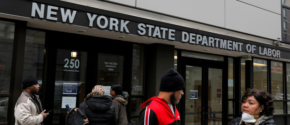 People gather at the entrance for the New York State Department of Labor offices, which closed to the public due to the coronavirus disease (COVID-19) outbreak in the Brooklyn borough of New York City, U.S., March 20, 2020. REUTERS/Andrew Kelly - RC2TNF9H6B22