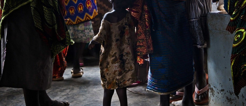 A girl waits in queue to receive relief food supplies at a hospital in Kakuma Refugee Camp, Turkana District, northwest of Kenya's capital Nairobi, August 8, 2011. The famine in the Horn of Africa is spreading and may soon engulf as many as six more regions of the lawless nation of Somalia, the U.N. humanitarian aid chief said.