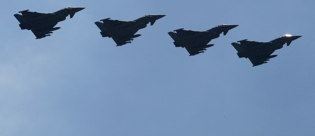 """Four Italian Air Force Eurofighter EF-2000 Typhoon fly over the Birgi NATO Airbase in Trapani on the southern Italian island of Sicily March 23, 2011. Western governments inched closer to a deal on Wednesday over who should lead military operations against Muammar Gaddafi's forces in Libya, with France saying NATO will have only a """" technical role"""" .     REUTERS/Tony Gentile   (ITALY - Tags: TRANSPORT MILITARY POLITICS CONFLICT) - GM1E73N1T9H01"""
