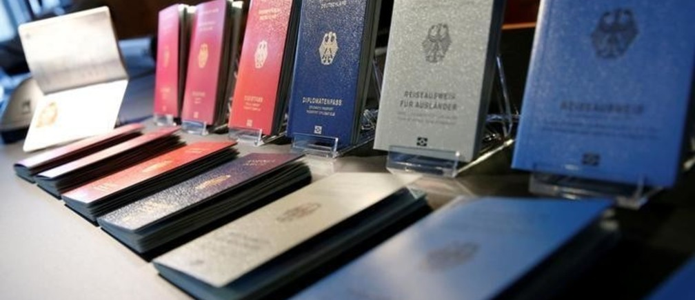 Specimens of the German new electronic passports are pictured during a presentation to the media in Berlin, Germany, February 23, 2017.     REUTERS/Fabrizio Bensch
