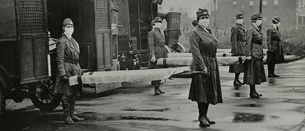 Mask-wearing women hold stretchers near ambulances during the Spanish Flu pandemic in St. Louis, Missouri, U.S. in October 1918.  Library of Congress/Handout via REUTERS THIS IMAGE HAS BEEN SUPPLIED BY A THIRD PARTY. - RC2U5G9ADB3Q