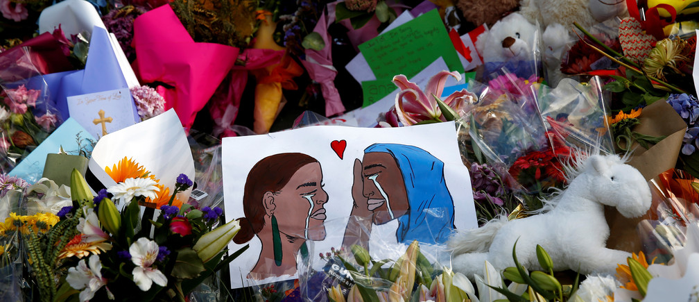 Flowers and cards are seen at the memorial site for the victims of Friday's shooting, outside Al Noor mosque in Christchurch, New Zealand March 19, 2019. REUTERS/Edgar Su - RC1BAB629B00