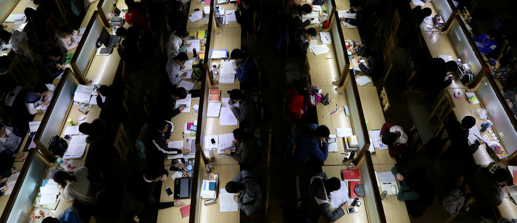Students study ahead of the entrance exam for postgraduate studies, at a library in Zhengzhou University in Zhengzhou, Henan province, China December 13, 2017. Picture taken December 13, 2017. REUTERS/Stringer ATTENTION EDITORS - THIS IMAGE WAS PROVIDED BY A THIRD PARTY. CHINA OUT.    REUTERS/Stringer CHINA OUT. NO COMMERCIAL OR EDITORIAL SALES IN CHINA     TPX IMAGES OF THE DAY - RC16CA98BD70