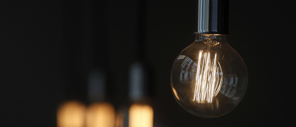 A bulb hangs inside a restaurant in Madrid.
