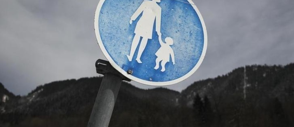 A traffic sign showing a mother with her child is pictured near the monastery in Ettal, some 100 kilometres (62 miles) south of Munich March 3, 2010. Officials in Bavaria started questioning at the Catholic monastery school on Tuesday in an investigation into child abuse of former pupils. REUTERS/Johannes Eisele (GERMANY - Tags: RELIGION CRIME LAW)