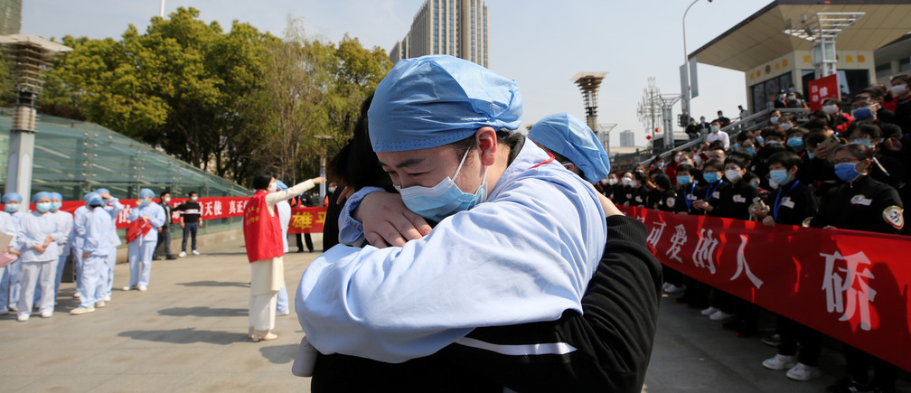 A local medical worker embraces and bids farewell to a medical worker from Jiangsu at the Wuhan Railway Station as the medical team from Jiangsu leaves Wuhan, the epicentre of the coronavirus disease (COVID-19) outbreak, in Hubei province, China Coronavirus china virus health healthcare who world health organization disease deaths pandemic epidemic worries concerns Health virus contagious contagion viruses diseases disease lab laboratory doctor health dr nurse medical medicine drugs vaccines vaccinations inoculations technology testing test medicinal biotechnology biotech biology chemistry physics microscope research influenza flu cold common cold bug risk symptomes respiratory china iran italy europe asia america south america north washing hands wash hands coughs sneezes spread spreading precaution precautions health warning covid 19 cov SARS 2019ncov wuhan sarscow wuhanpneumonia  pneumonia outbreak patients unhealthy fatality mortality elderly old elder age serious death deathly deadly