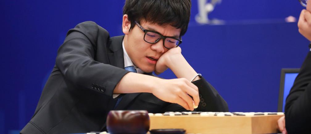 Ke Jie competes against Google's artificial intelligence program AlphaGo.
