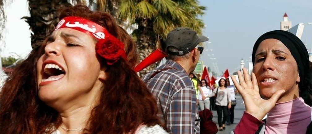 Protesters shout slogans during a march, demanding equal inheritance rights for women, in Tunis, Tunisia March 10, 2018.