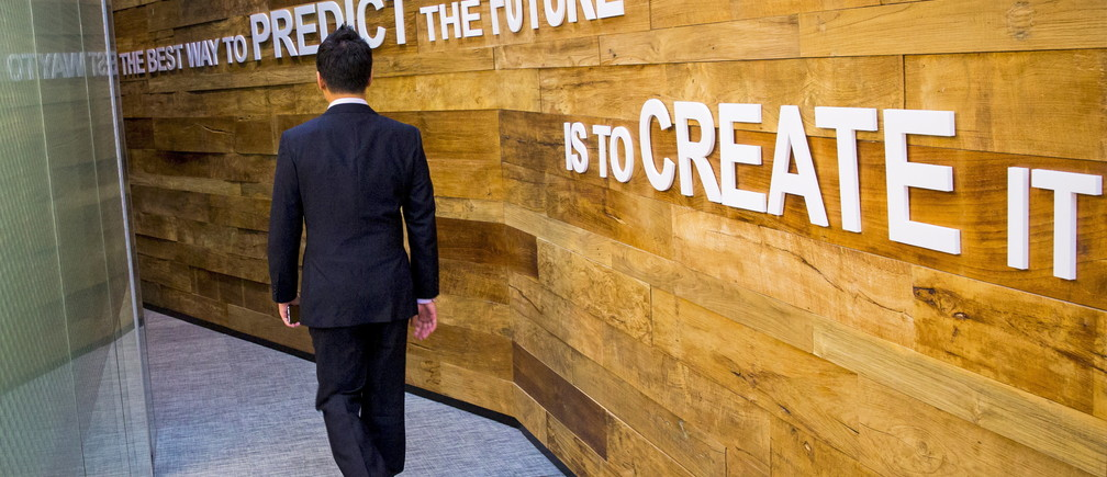 A man walks past a slogan at the Google Campus start-up space in the Gangnam district of Seoul.