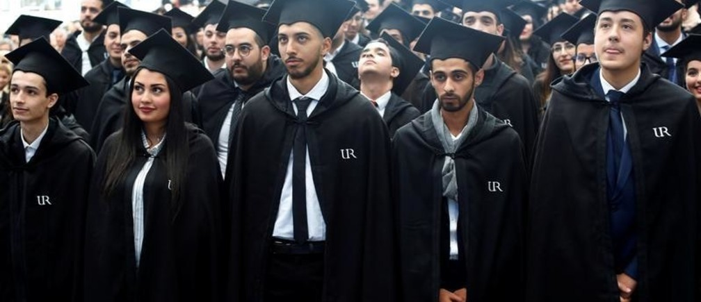 Students wearing mortar board hats wait to receive their degree diplomas following a graduation ceremony for students at University of Rabat, Morocco, February 2, 2019. Picture taken February 2, 2019. REUTERS/Youssef Boudlal - RC11F2292600
