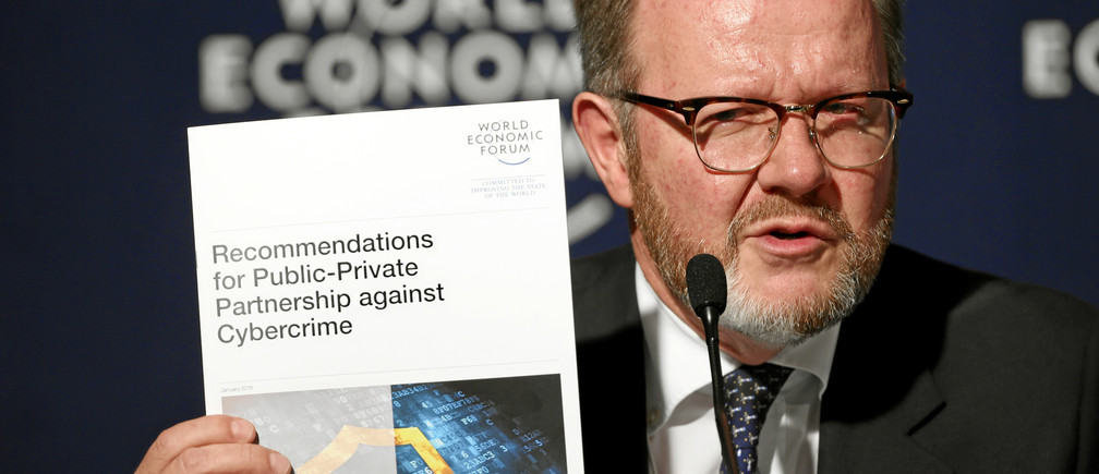 DAVOS/SWITZERLAND, 22JAN16 - Jean-Luc Vez, Head of Public Security Policy and Security Affairs, Member of the Executive Com, World Economic Forum shows a brochure during a press conference at the Annual Meeting 2016 of the World Economic Forum in Davos, Switzerland, January 22, 2016.  WORLD ECONOMIC FORUM/swiss-image.ch/Photo Moritz Hager