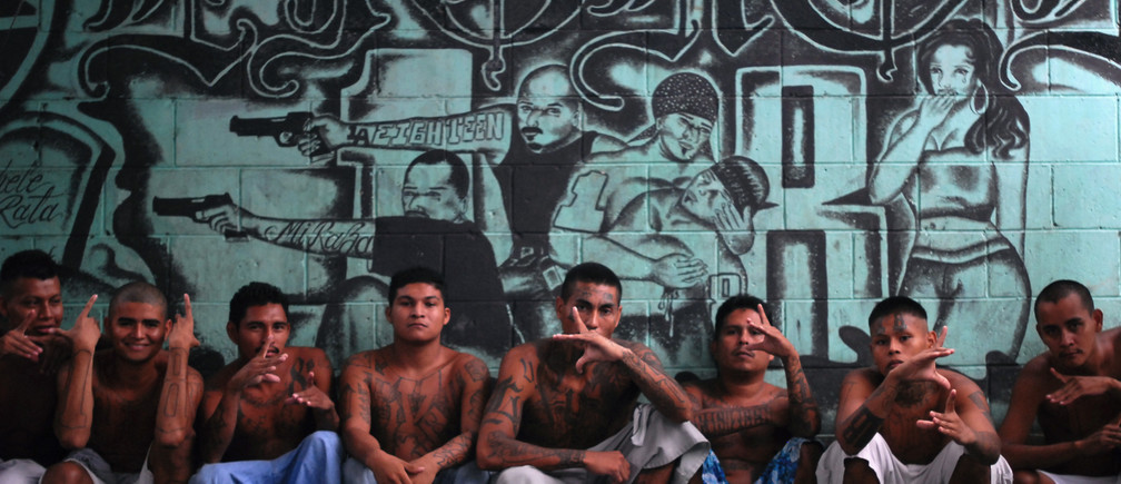 """Gang members who are also inmates pose for a photograph at a prison in Quezaltepeque, on the outskirts of San Salvador June 2, 2012. The relentless tit-for-tat murders between El Salvador's two largest street gangs - """"Calle 18"""" and """"Mara Salvatrucha"""" - made the country the most murderous in the world last year after neighboring Honduras, also ravaged by gang violence. That was until Garcia, from the Calle 18 (""""18th Street"""") gang, along with elders from the Mara Salvatruchadeclared an unprecedented truce that authorities say has cut the homicide rate in half in just four months. Picture taken June 2, 2012. To match Feature SALVADOR-GANGS/   REUTERS/Ulises Rodriguez (EL SALVADOR - Tags: CRIME LAW CIVIL UNREST) - GM1E87F192T01"""