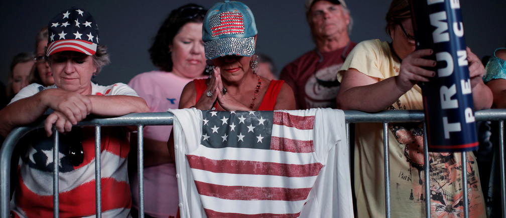 Supporters of Republican U.S. presidential nominee Donald Trump bow their heads in prayer at a campaign rally in Panama City, Florida, U.S., October 11, 2016.   REUTERS/Mike Segar - RTSRULK