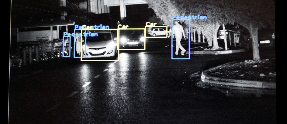 A screen, part of night vision technology developed by BrightWay Vision (BWV), an Israeli start-up who claim they have developed a technology to help autonomous vehicles navigate more safely at night, is seen during a demonstration for Reuters, in Haifa, Israel November 5, 2018. Picture taken November 5, 2018. REUTERS/Amir Cohen - RC16B4BD5B40