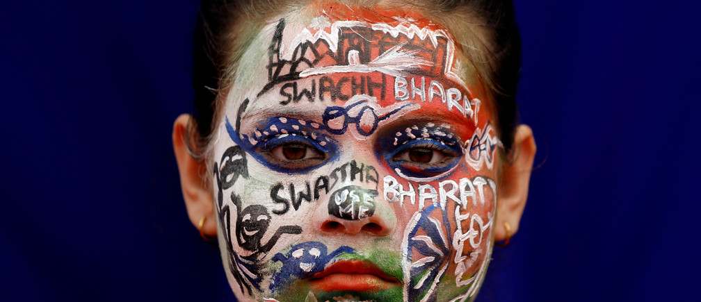 A school girl with painted face participates in an event to mark World Toilet Day in New Delhi, India, November 19, 2018.
