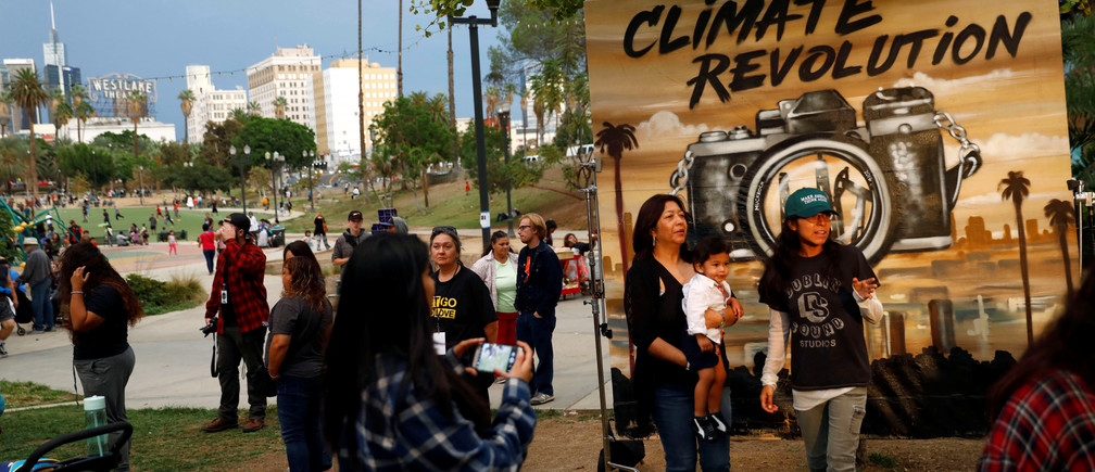 People attend a climate change rally in solidarity with protests of the pipeline in North Dakota at MacArthur Park in Los Angeles, California October 23, 2016. REUTERS/Patrick T. Fallon - S1AEUITHNVAA
