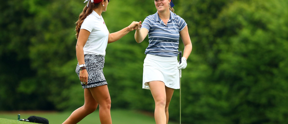 Apr 6, 2019; Augusta, GA, USA; Maria Fassi of Mexico and Jennifer Kupcho of Westminster, Colo. (right) bump fists on the 12th tee box during the Augusta National Women's Amateur golf tournament at Augusta National GC. Mandatory Credit: Rob Schumacher-USA TODAY Sports - 12487413