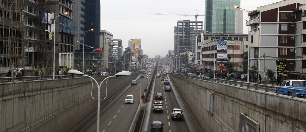 Cars drive out of an underpass in Addis Ababa May 26, 2014. Ethiopia has pushed the door ajar for foreign retailers keen to enter the fast-growing market of 90 million people, welcoming them as managers but keeping the state in control.