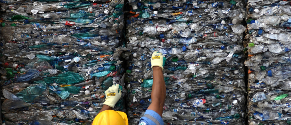 An officer shows a container full with plastic waste at Tanjung Priok port in Jakarta, Indonesia, September 18, 2019 in this photo taken by Antara Foto.  Antara Foto/Aditya Pradana Putra/Handout via REUTERS. ATTENTION EDITORS - THIS IMAGE WAS PROVIDED BY A THIRD PARTY. MANDATORY CREDIT. INDONESIA OUT. - RC1F94DF8000