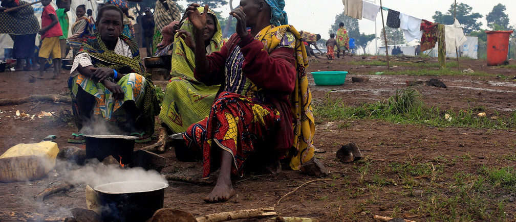 Congolese families, who fled from Democratic Republic of Congo by fleeing on a boat across Lake Albert, prepare meals at United Nations High Commission for Refugees' (UNHCR) Kyangwali refugee settlement camp.