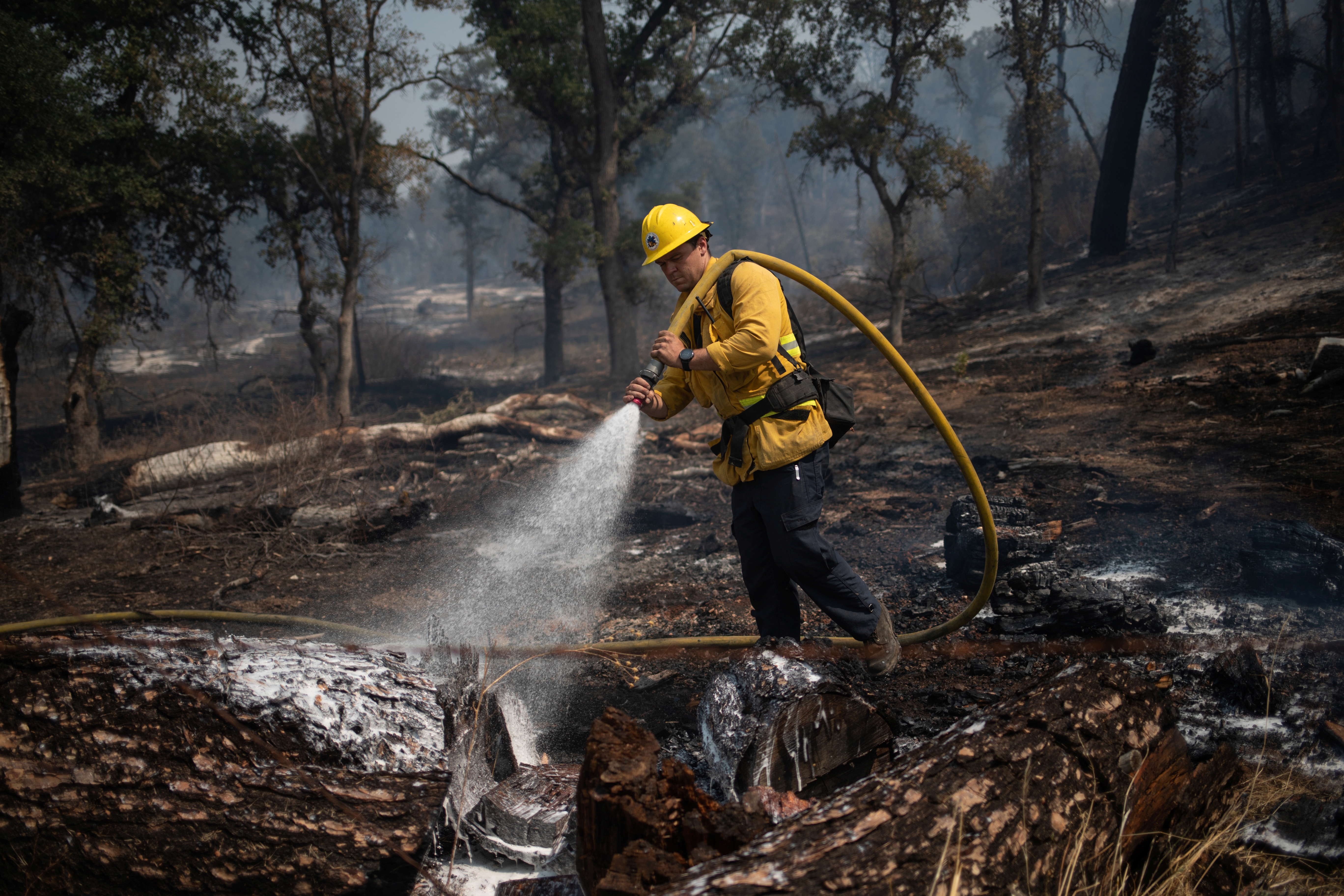 Ventura County firefighter Tommy Minadeo mops up the LNU Lightning Complex Fire in Pope Valley, California, U.S. August 23, 2020. REUTERS/Adrees Latif - RC2ZJI9ZXCFW