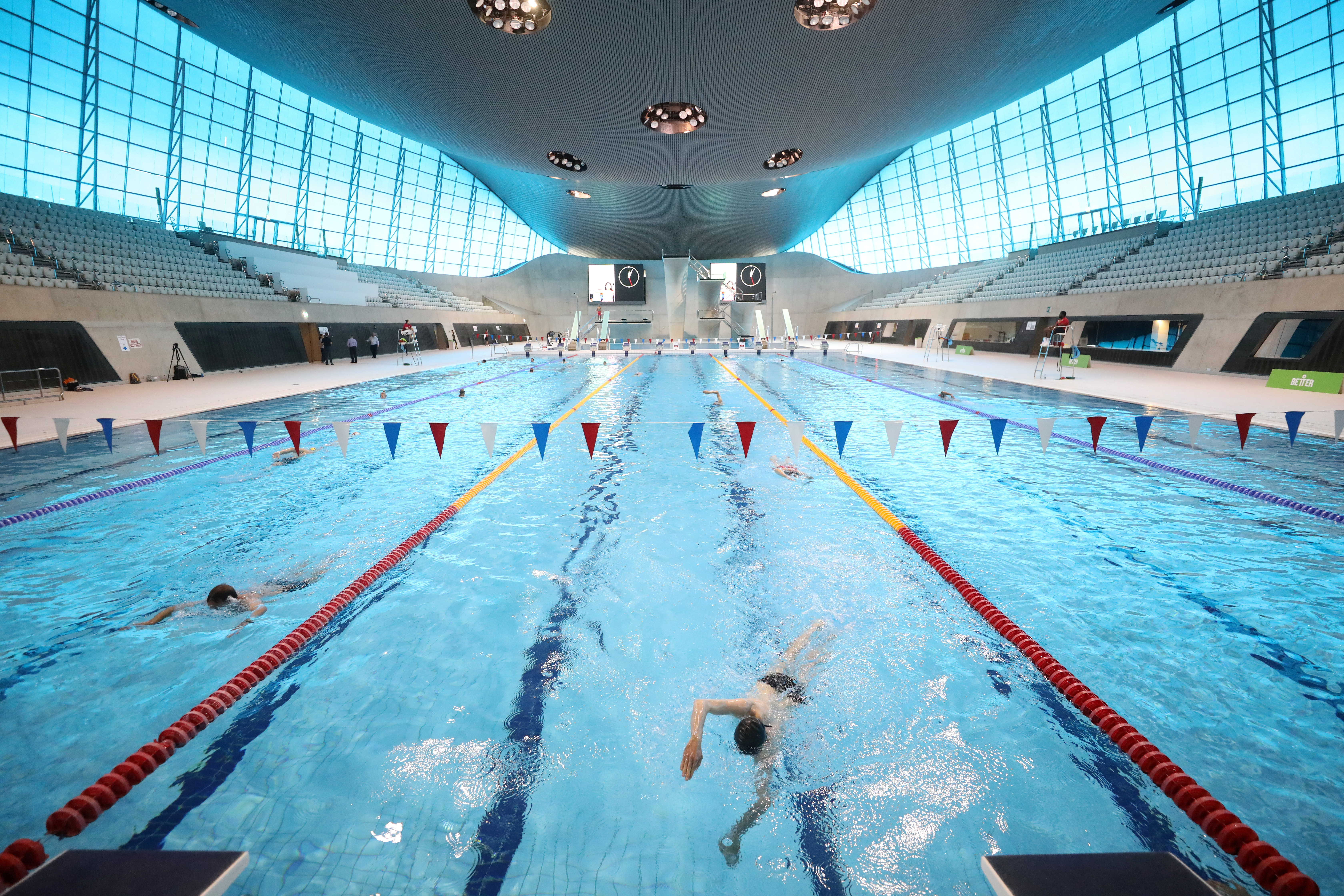 People swim at the London aquatics centre following the reopening of swimming pools as the spread of the coronavirus disease (COVID-19) continues, in London, Britain, July 25, 2020. REUTERS/Simon Dawson     TPX IMAGES OF THE DAY - RC2C0I98JKD7