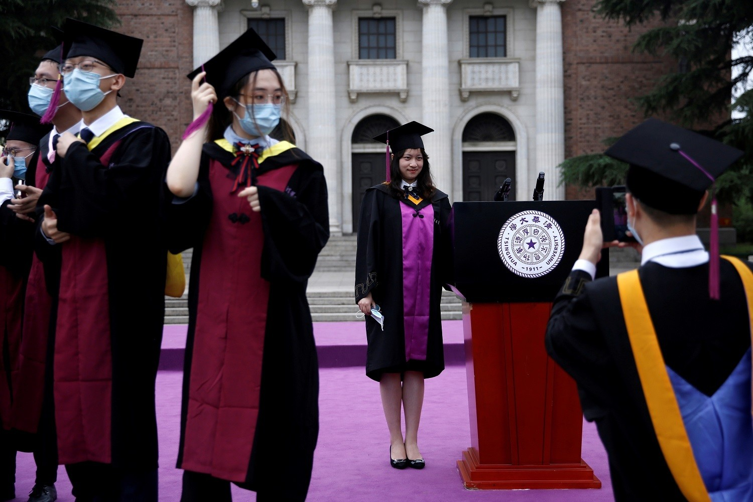 Undergraduate students pose for photos as they attend a graduation ceremony in Tsinghua University, following the outbreak of the coronavirus disease (COVID-19), in Beijing, China June 23, 2020. REUTERS/Tingshu Wang     TPX IMAGES OF THE DAY - RC2SEH9SN936
