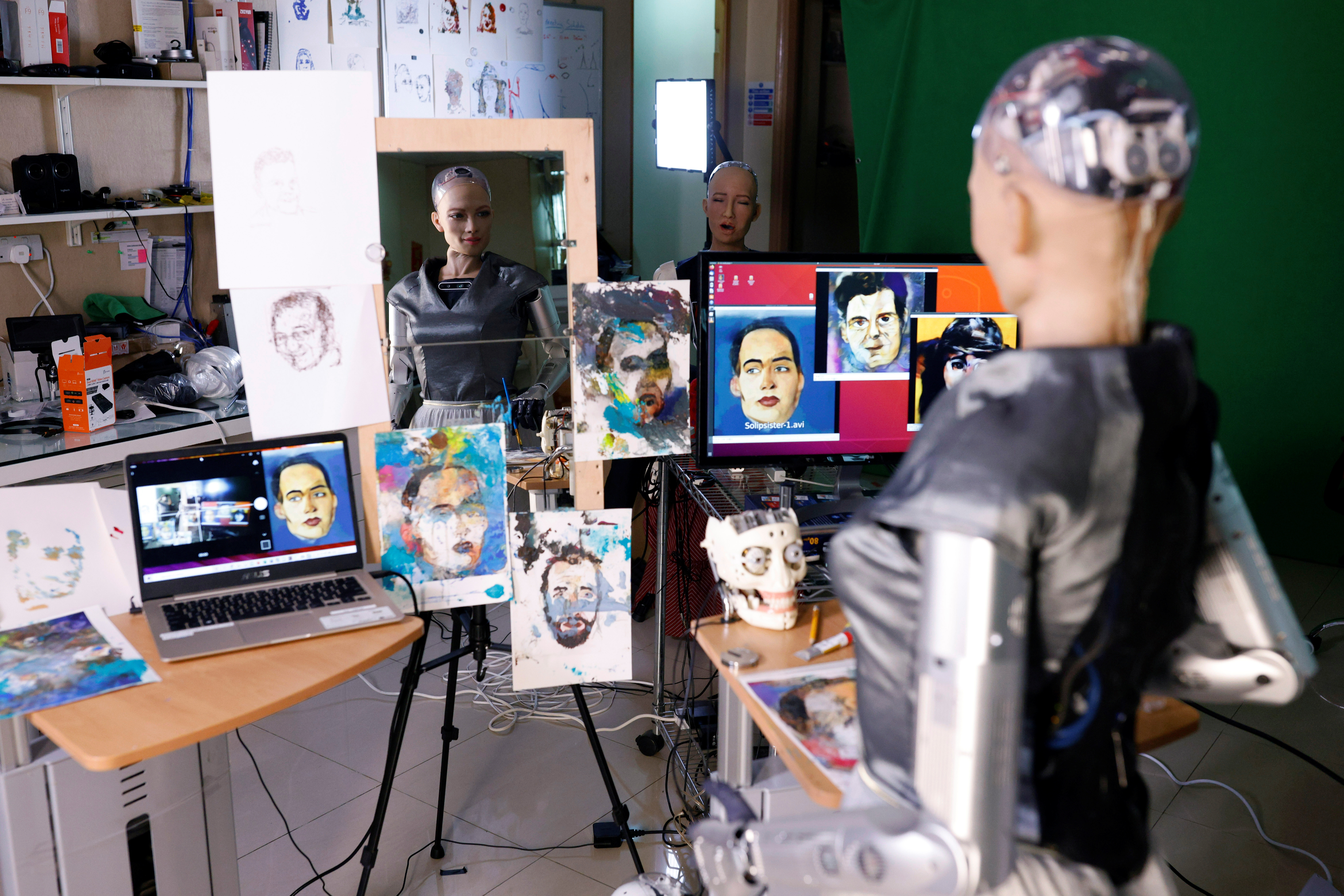 a humanoid robot is pictured painting