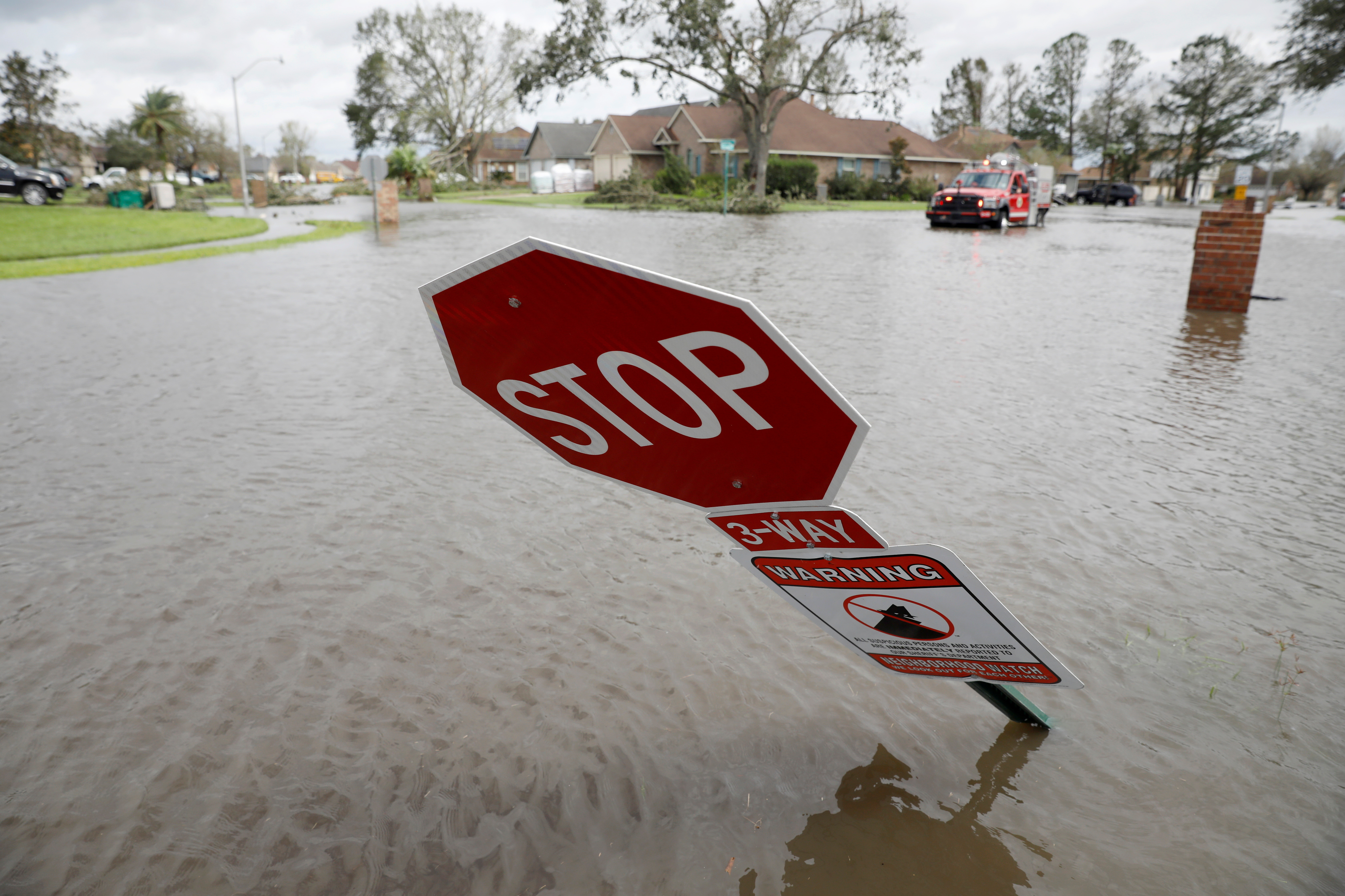 A flooded street is pictured after Hurricane Ida made landfall in Louisiana, in Laplace, Louisiana, U.S. August 30, 2021. REUTERS/Marco Bello - RC2RFP9QSW24