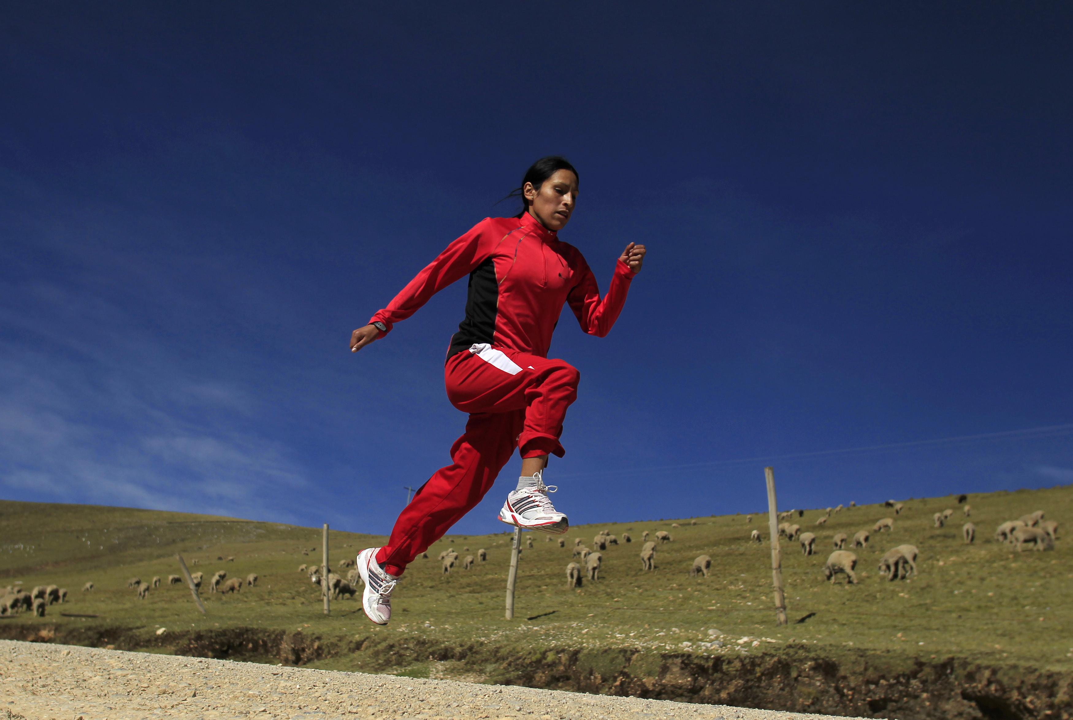 a woman runs in a field
