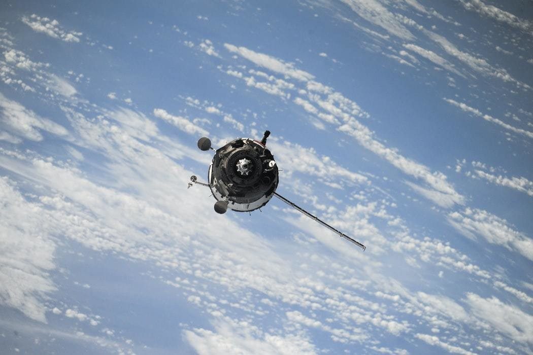 image of a satellite in flight