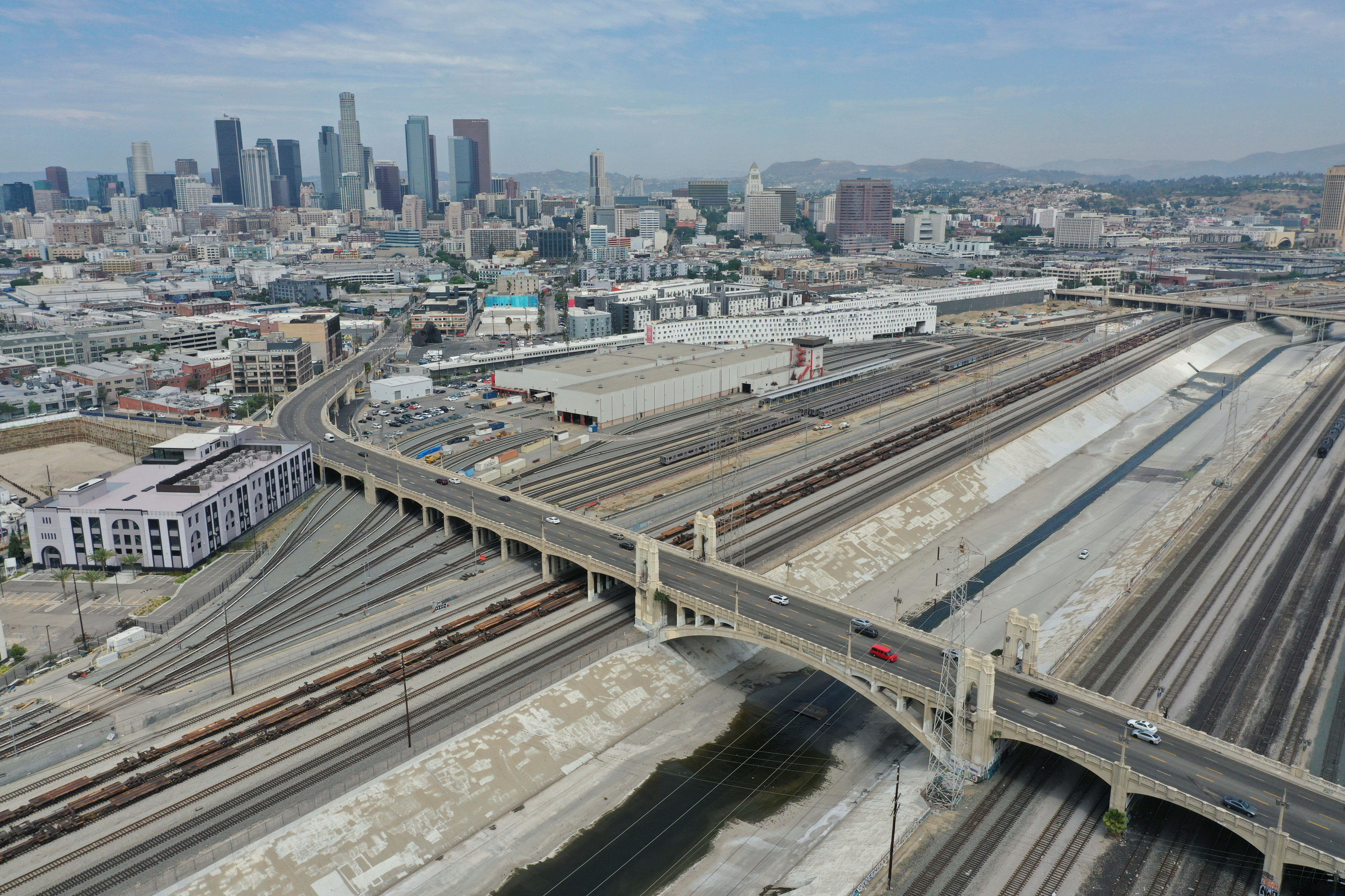 An aerial view of the Metro Division 20 Rail Yard and the Fourth Street Viaduct over the Los Angeles River in Los Angeles, California, U.S., August 11, 2021. Picture taken with a drone. REUTERS/Bing Guan - RC2Y2P9D5WIL