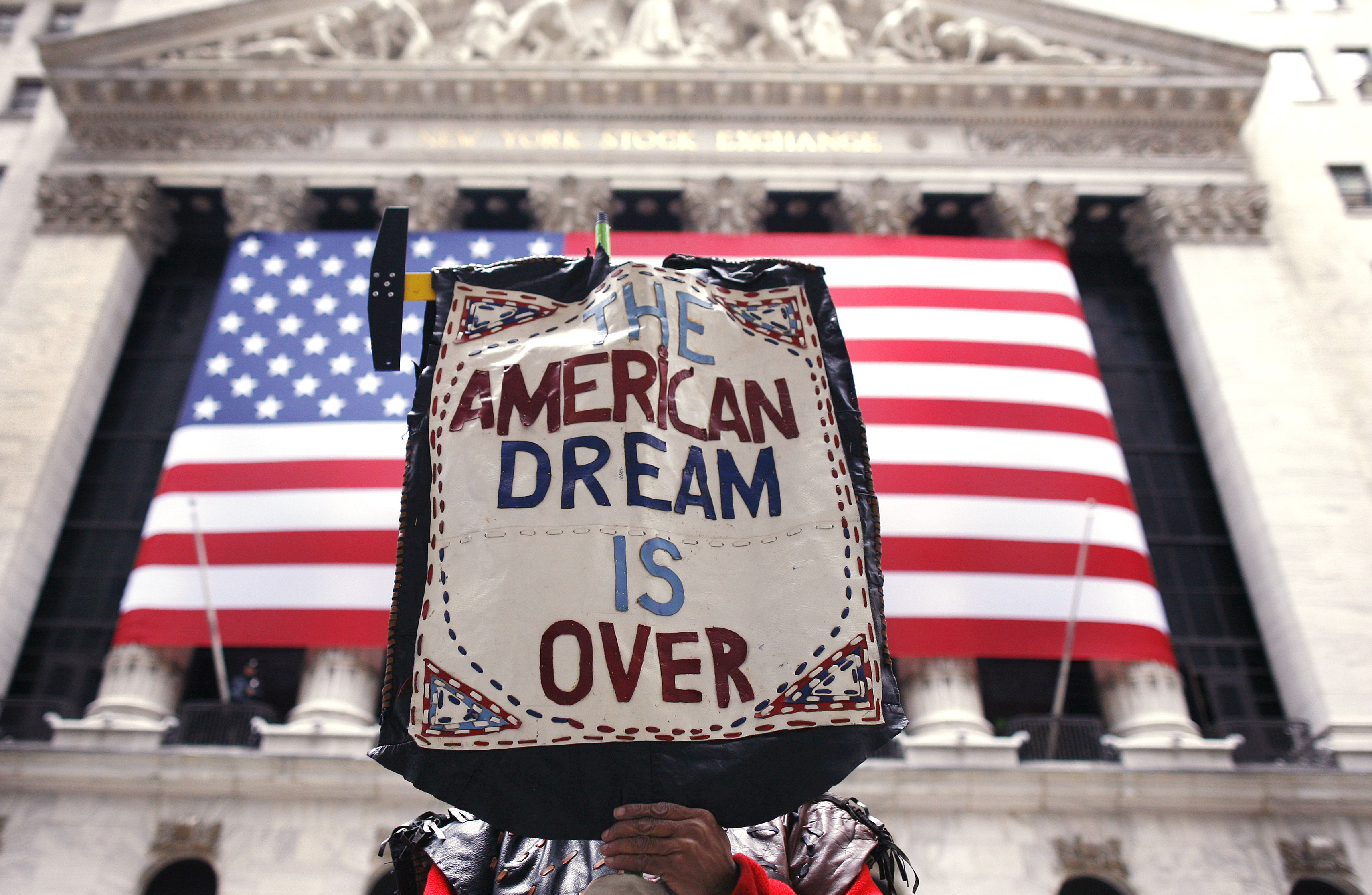 "A demonstrator holds a sign reading ""the American dream is over"" during a rally outside Wall Street in New York April 4,2009.     REUTERS/Shannon Stapleton (UNITED STATES BUSINESS SOCIETY IMAGE OF THE DAY TOP PICTURE) - GM1E54507NA01"