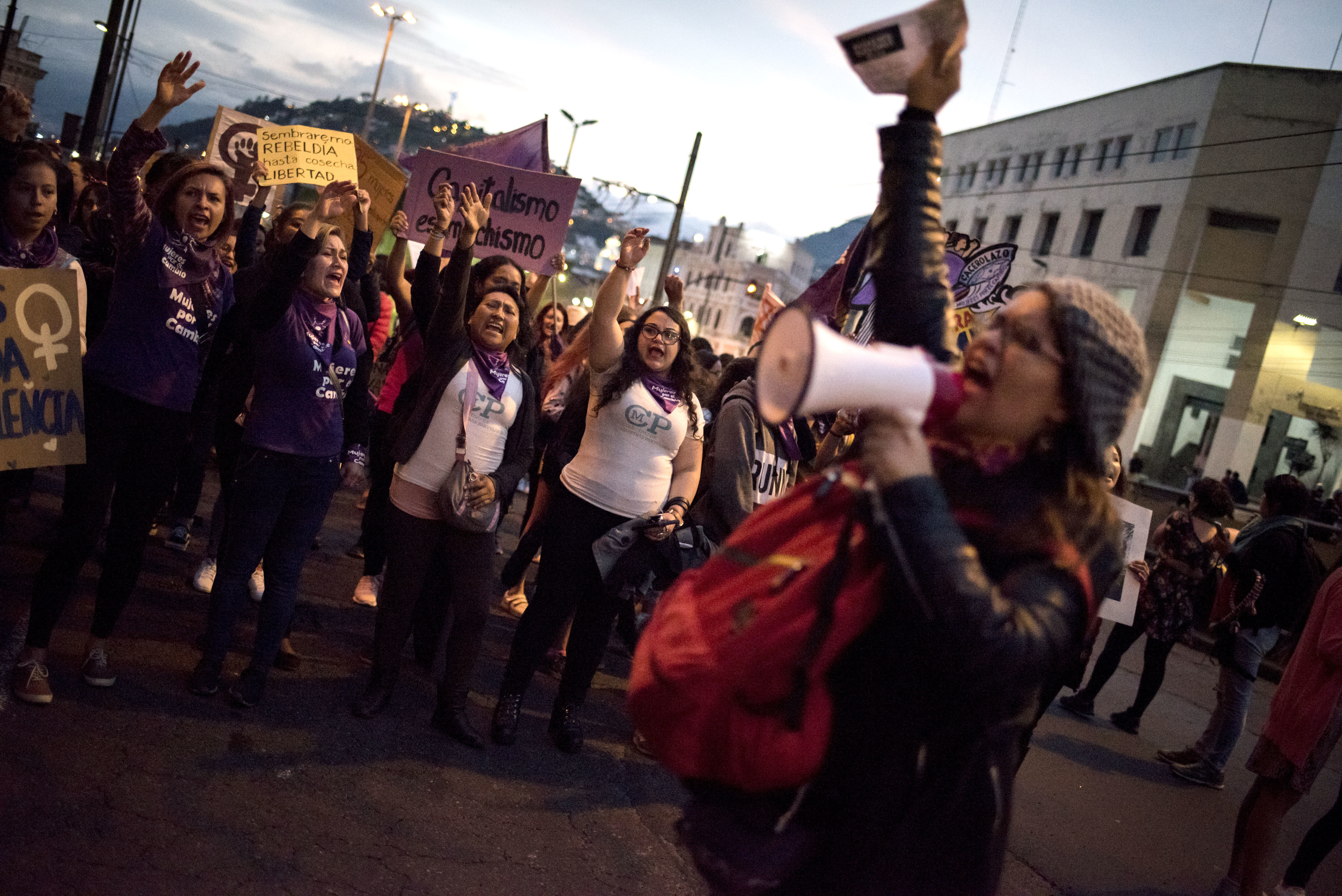 """: Participants in the """"Vivas Nos Queremos"""" march demonstrate against gender-based violence."""