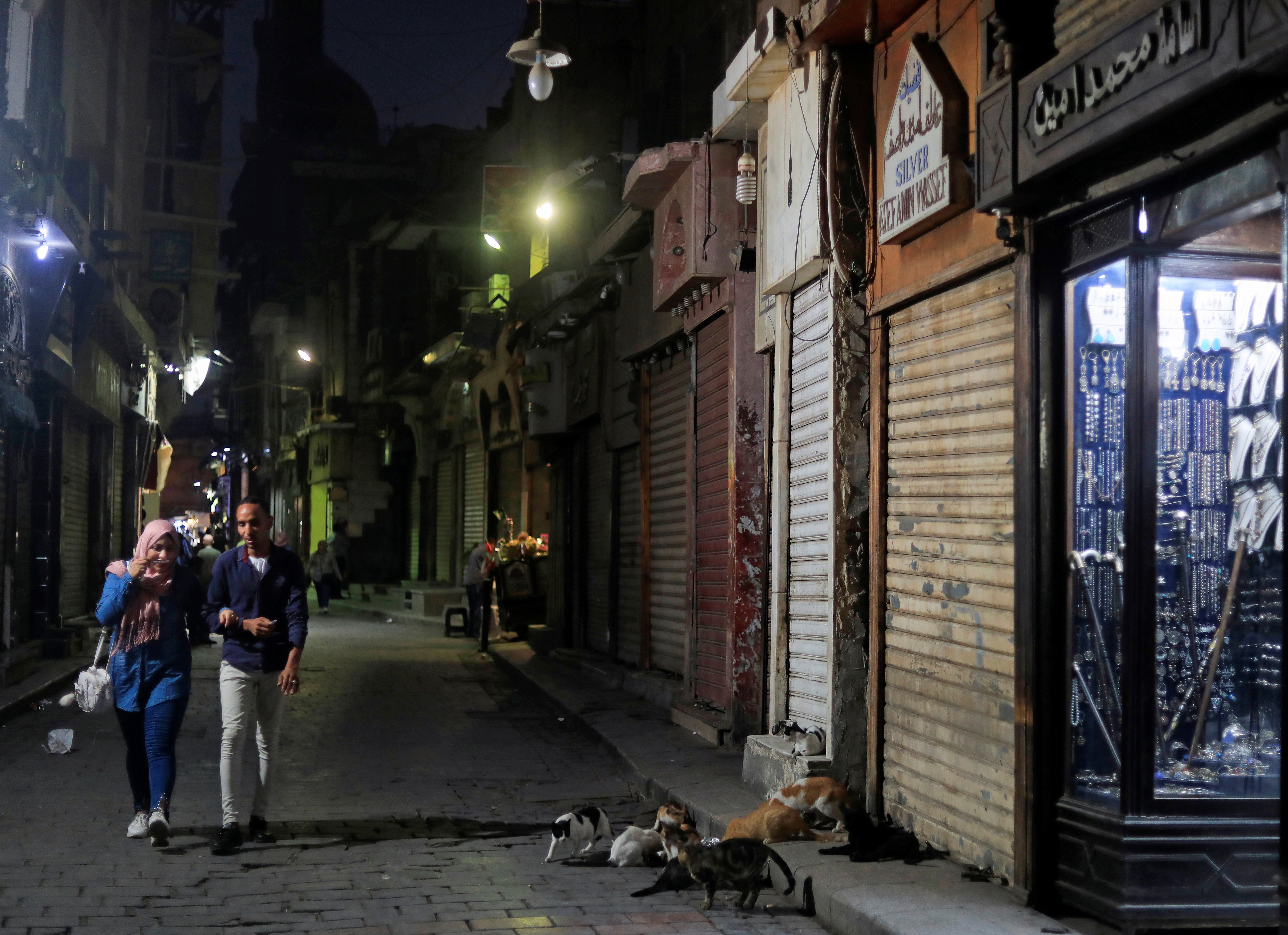People walk past closed shops at the gold market street following the outbreak of the coronavirus disease (COVID-19), in old Cairo, Egypt July 26, 2020. Picture taken July 26, 2020. REUTERS/Amr Abdallah Dalsh - RC2O1I9EWBEJ