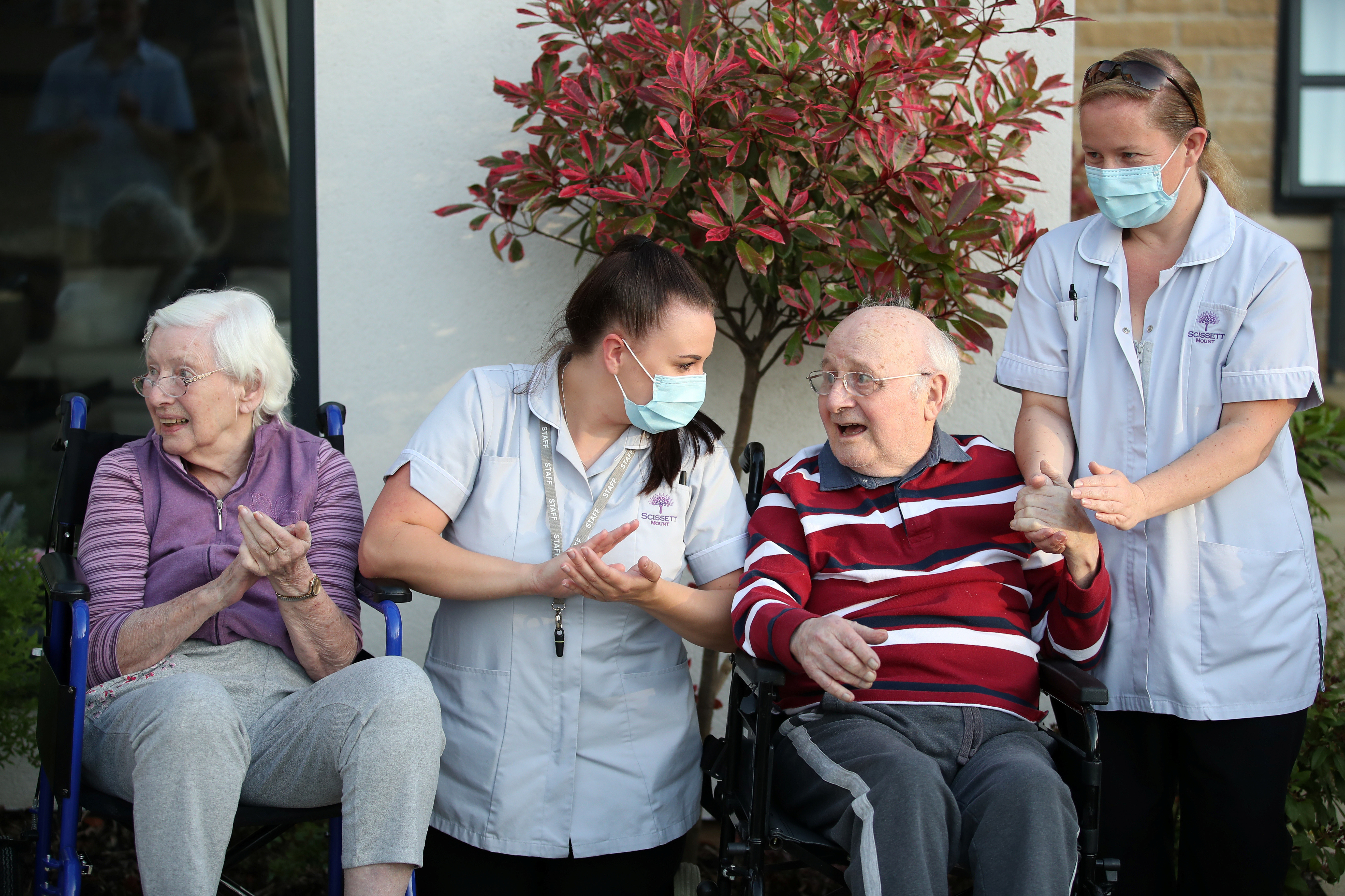 Care workers and residents of the Scisset Mount Care Home react during the last day of the Clap for our Carers campaign in support of the NHS, following the outbreak of the coronavirus disease (COVID-19), Huddersfield, Britain, May 28, 2020.