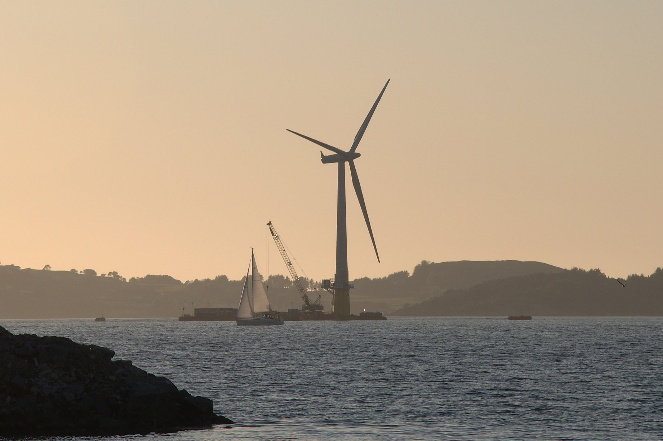 The world's first full-scale floating wind turbine, Hywind, being assembled in the Åmøy Fjord near Stavanger, Norway in 2009, before deployment in the North Sea