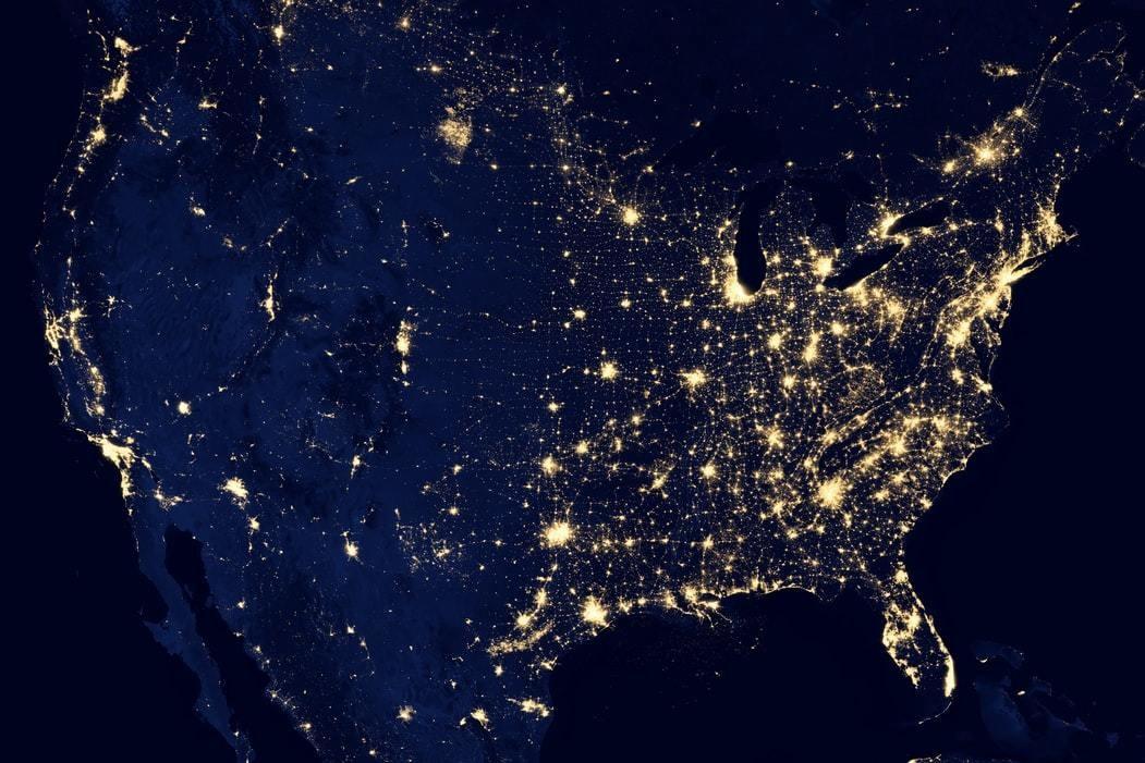 NASA image of a world map lit up at night